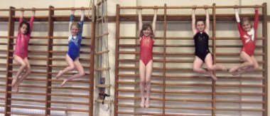 Gymnasts on wall bars