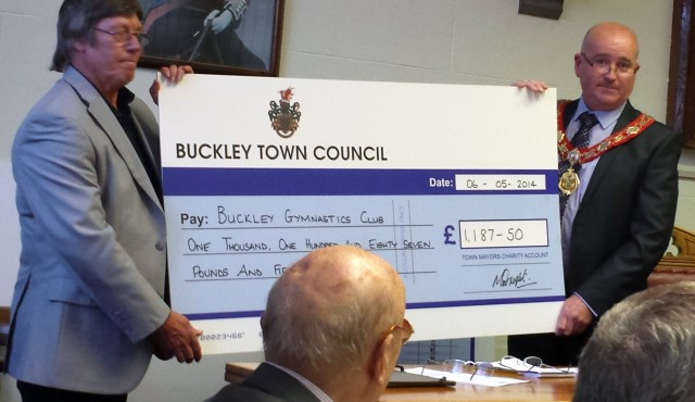 Stan receives a cheque on behalf of the club from Buckley Town Council