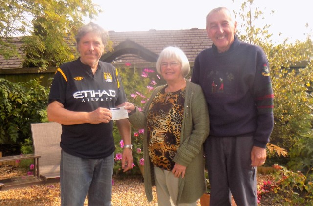Steve Bailey (left) receives the cheque from Viv and Don Bennion
