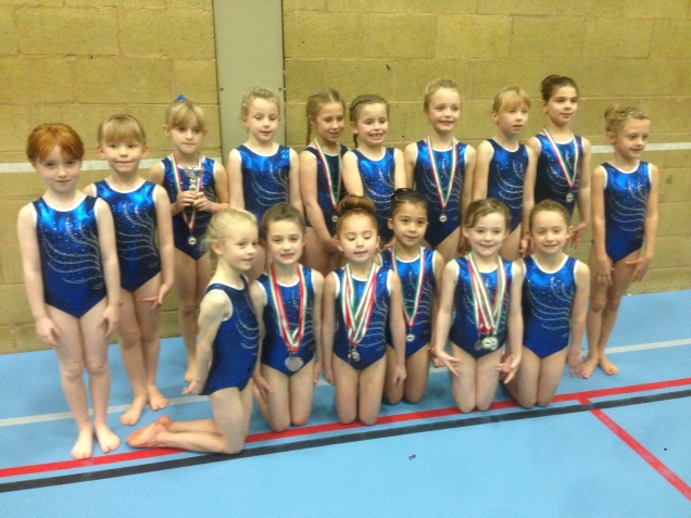 Sasha Johnson is pictured (back row, 3rd from left) with fellow gymnasts competing in the 6&7 beginners competitions.
