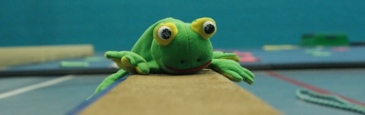 Toy frog on beam