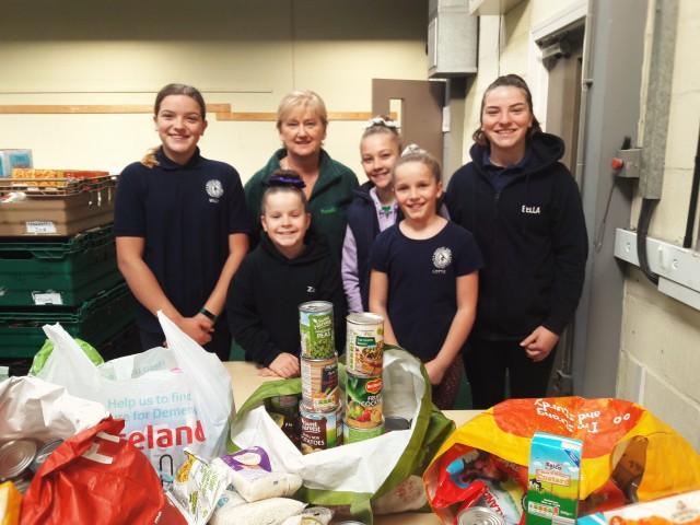 Girls drop off food at Flintshire Foodbank