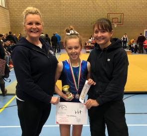 Lucy with coaches Shelley and Emily