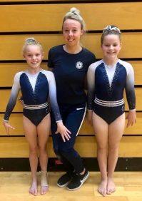 Mia and Zara with coach Tara